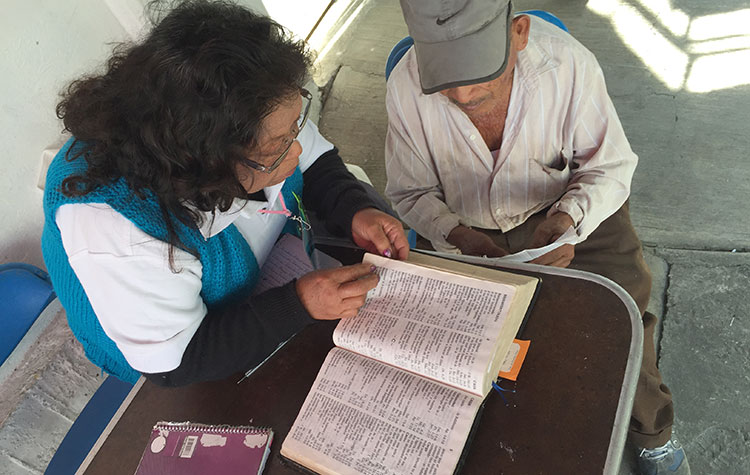 An OSI Ministry team member shares the Word of God